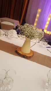 Hessian runner with log slice and jug of gyp