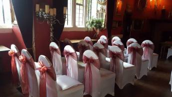 Burgundy sashes at the Churston court